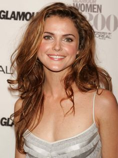 Famous for her tight curls, Keri Russell looks stunning with more relaxed waves