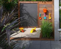 Sandpit, blackboard & kids tools on wall