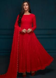 Thread Embroidered Anarkali Red Thread Embroidered Anarkali features a georgette kameez with santoon inner, santoon bottom and embroidered georgette dupatta. Embroidery work is completed with thread, sequins and stone embellishments on this style. Indian Gowns Dresses, Indian Fashion Dresses, Dress Indian Style, Indian Designer Outfits, Pakistani Dresses, Indian Wear, Pakistani Clothing, Indian Suits, Fashion Clothes