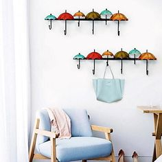 Retro wall hanging with little umbrellas. Don't you love the design? Click to shop!