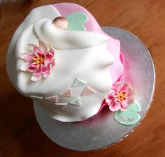 Pink baby naming day cake, with water lilies and lily pads