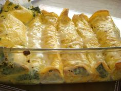 Cannelloni made of egg crepes and filled with spinach and ricotta