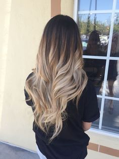 Back view of brunette to blonde ombre hair – long hairstyl