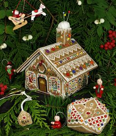 Victoria Sampler Gingerbread Stitching House - Cross Stitch Pattern. Models stitched on 28 count Antique Almond Cashel Linen with Kreinik Mori, Needlepoint Inc.