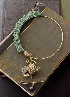 Add a traditional touch to modern jewelry making by crocheting around the wire, with this tutorial by Kim Vagnone inside Belle Armoire Jewelry.