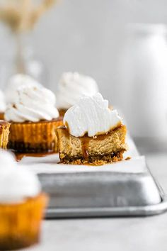 Mini Salted Caramel Pumpkin Cheesecakes | Browned Butter Blondie | This mini cheesecake recipe is the ultimate pumpkin Thanksgiving dessert. Full of delicious Fall flavors, these mini desserts have a crunchy gingersnap crust and a smooth and creamy pumpkin filling all drenched in a rich homemade salted caramel. Topped with a swirl of freshly whipped cream, a holiday dessert that will be the hit of your dinner party or gathering! Mini Cheesecake Recipes, Homemade Cheesecake, Pumpkin Cheesecake, Bite Size Desserts, Mini Desserts, Holiday Desserts, Holiday Recipes, Salted Caramel Desserts, Recipes Using Fruit
