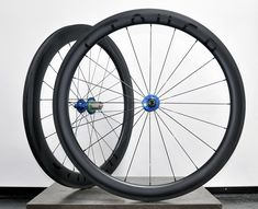 Stayer Carbon x Hope RS4 with Sapim CX-Rays. Clincher or tubeless rim brake 50/60mm 700c aero road racing wheels.  Blue hubs, gloss black decals. £919