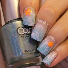 Beach Inspired Nails with watermarbling and reverse stamping