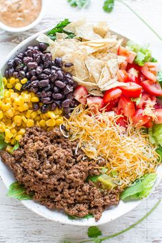 Loaded Beef Taco Salad with Creamy Lime Cilantro Dressing - Loaded with your favorite taco fixings, minus the shells, to keep things healthier without sacrificing any FLAVOR!! The dressing is easy, creamy and IRRESISTIBLE!!
