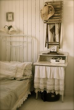 adore this little skirted bedside table