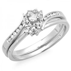 Dainty and delicate surprise the woman you love with this exquisite bridal set. Fashioned in 10K white gold the engagement ring features a cleverly bypassing shank lined with shimmering diamonds leading to the brilliant 0.08 ct. round diamond center stone. On your wedding day complete the ensemble by adding the coordinating wedding band bringing additional diamonds to this exceptional design.