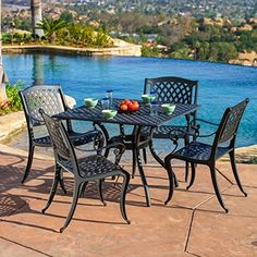 Outdoor Cayman Cast Aluminum Black Sand Dining Set by Christopher Knight Home (Hallandale Black Sand Outdoor Dining Set), Size Sets, Patio Furniture Outdoor Tables And Chairs, Outdoor Dining Set, Patio Chairs, Outdoor Decor, Patio Dining, Dining Sets, Dining Chairs, Outdoor Spaces, Outdoor Living