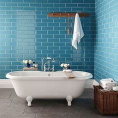 Blue subway tiles look great in this bathroom.