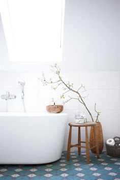 bathroom | tiles - love all the white with the pop of color on the floors in the bathroom! love this.