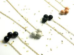 Nothing like Neutrals...    Three wooden beads coated in acrylic color and strung on your choice of a gold plated or silver finish chain. **This listing