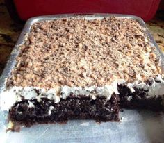 Ingredients : 1 box Dark Chocolate Fudge cake 1 can sweetened condensed milk 1 jar caramel ice cream topping 1 large tub Cool Whip 1 (8oz.) Heath milk chocolate toffee bits Directions : Prepare and cook cake as directed on the box
