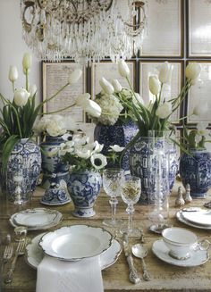 Beautiful Blue & White table setting with white flowers, silver and crystal.