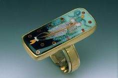 Lundell ; Feather Ring  1.5 x1 inches  24,22,14 K. gold