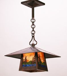Buffalo Studios Hammered Copper Hanging Lantern With Exquisite Cutout Landscape Design Over Stained Glass Circa 1980s
