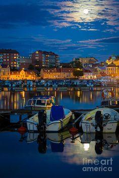 Moonrise over small boat marina in Karlskrona, Blekinge County_ Sweden