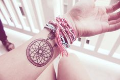 Simple wrist dreamcatcher tattoo - The symmetry of the web is not perfect, it needs a bit of fixing and you're good to go. #TattooModels #tattoo