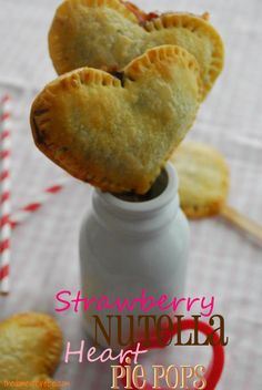 Valentine's Strawberry/Nutella Heart Pie Pops (@Taylor Chatfield Pie on a stick...reminded me of you. Obvs.)