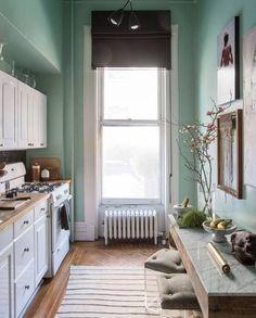 sage green kitchen walls, striped rug
