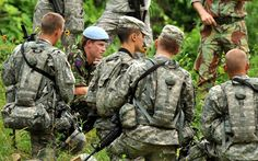25 June 2010: Prince Harry talks to US Army Officer Cadets after a foot patrol training exercise during a visit to Westpoint Military Academy  in New York