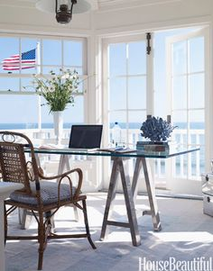 Ocean View  Designer Carolyn Espley-Miller decorated her Carpinteria, California home with a clean, crisp style. Her office is surrounded by windows, giving her an incredible view of the ocean.