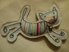 Felt cat that could be changed into a reindeer for xmas dec from cottagecraftsireland.blog