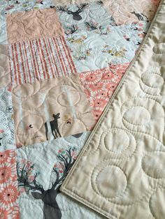 Adorable baby girl quilt - fawn - deer - modern - rustic - woodland - blanket - baby crib or nursery quilt. This adorable baby quilt features a collection of fabrics I love. This listing is for a baby quilt. It features 3 total layers and has a light to medium weight. The middle layer