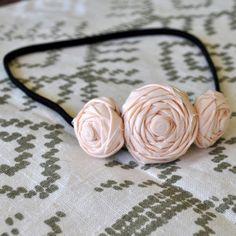 headband  http://www.etsy.com/listing/61792911/softest-pink-rosette-flower-headband?ref=af_you_favitem