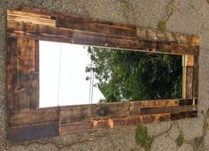 Burned Mirror: Rugged Handmade torch Pallet Wood Mirror with a Mix of Natural Colors. Awesome piece.
