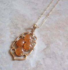 Apricot Jade Necklace 14K Yellow Gold 18 Inch Chain V0742 by cutterstone on Etsy  #jadenecklace #apricotjade #14Kgold #vintage #unusualjade