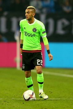 Hakim Ziyech of Amsterdam runs with the ball during the UEFA Europa League quarter final second leg match between FC Schalke 04 and Ajax Amsterdam at Veltins-Arena on April 20, 2017 in Gelsenkirchen, Germany.