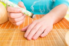 Moxibustion is an effective treatment for pain and many other health problems. Shutterstock/Monika Wisniewska