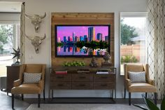 The TV becomes a work of art when mounted on an accent wall. The aluminum cast cow skulls add *just* the perfect Texas touch. --> http://www.hgtv.com/design/hgtv-smart-home/2015/articles/living-room-from-hgtv-smart-home-2015?soc=smartpin