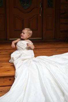 """my daughter Elle in my wedding dress. I plan to take this picture every year. (2011 - 1 year old)"" -- such a cute idea!"