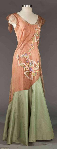 "EMBELLISHED EVENING GOWN, 1930s |  May 9, 2017 Sturbridge, Massachusetts |  Rose taffeta underdress overlaid w/ copper tulle & sage hem, CB tulle drape, silk ribbontrim, B to 38"", W 28"", L 60"", NY label ""Blanche Yovin"", (holes to net, long light hem stains) very good. MCNY"