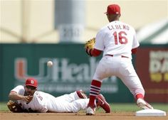 second baseman Daniel Descalso,after making a diving stop, tosses the ball to infielder Ronny Cedeno for the force out during a spring training game vs the Nationals.  Cards lost 6-2.  3-02-13