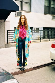 Sophie Koella in a vintage kimono, Gucci silk plissé shirt, vintage flared denim jeans, and Gucci Princetown slippers
