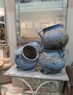 Mid-20th century French garden pots in front of a late 19th century Venetian mirror on the stand of Puckhaber Antiques at the Decorative Fair