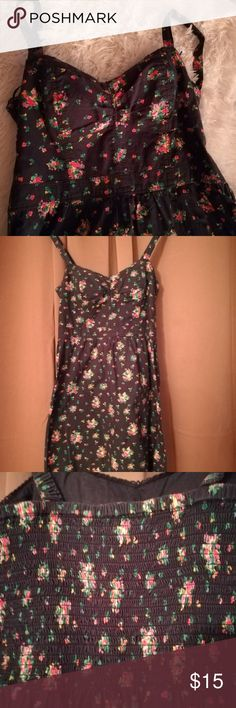 American eagle floral spaghetti strap sundress Super cute navy blue floral sundress ,  Sleeveless flairy  Goes with any thing  Super cute with flats, sandals even a pair of boots. american eagle Dresses Midi