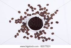COFFEE IN A WHITE RAMEKIN AND COFFEE BEANS AGAINST A WHITE BACKGROUND. PHOTO CREDIT: MICHAEL MORIARTY PHOTOGRAPHY
