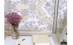 """Cover cubicle panels with """"wallpaper."""" To attach the fabric to the panels, begin pinning (with sewing pins) from the middle, moving outward. Fold the edges over and pin in place. If you're picky about edges, use a cotton ribbon to finish them off. Cubicle Walls, Work Cubicle, Cubicle Ideas, Cubicle Decorations, Cute Cubicle, Cubicle Design, Cubicle Makeover, Office Makeover, Cubicle Wallpaper"""
