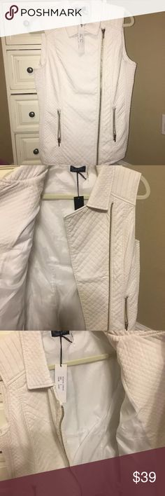 Nordstrom Love Token Faux Leather Vest Snow white quilted vest. It's a small but fits alittle bigger. Maybe a small/medium person. No signs of wear Nordstrom Jackets & Coats Vests