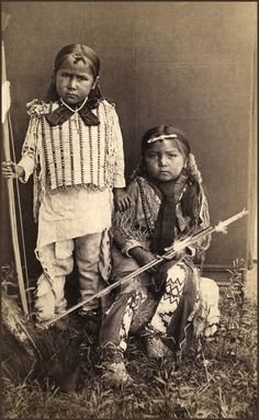 Two beautiful little Kiowa Boys, photographed at Fort Sill, Indian Territory, 1890 by H. P. Robinson.