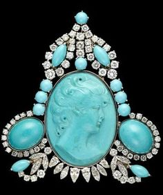 20th c. Persian turqouise and diamond brooch Turquoise cameo framed by turquoise cabochons accented by petite marquise and round cut diamonds set in platinum, can be worn as a brooch or as a pendant. Total carat weight apparoximately 5.5 carats.