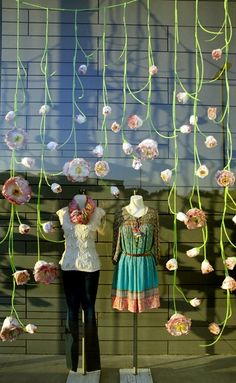 Great display for a children's store. Store Display / Anthropologie = It would be so much fun to hang paper flowers like this with yarn Visual Merchandising Displays, Visual Display, Display Design, Store Design, Display Ideas, Spring Window Display, Store Window Displays, Boutique Window Displays, Hanging Paper Flowers