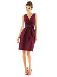 Alfred Sung dresses in burgundy